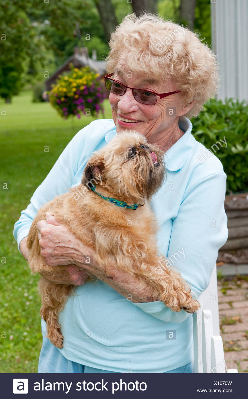 Senior woman with her dog - Stock Image
