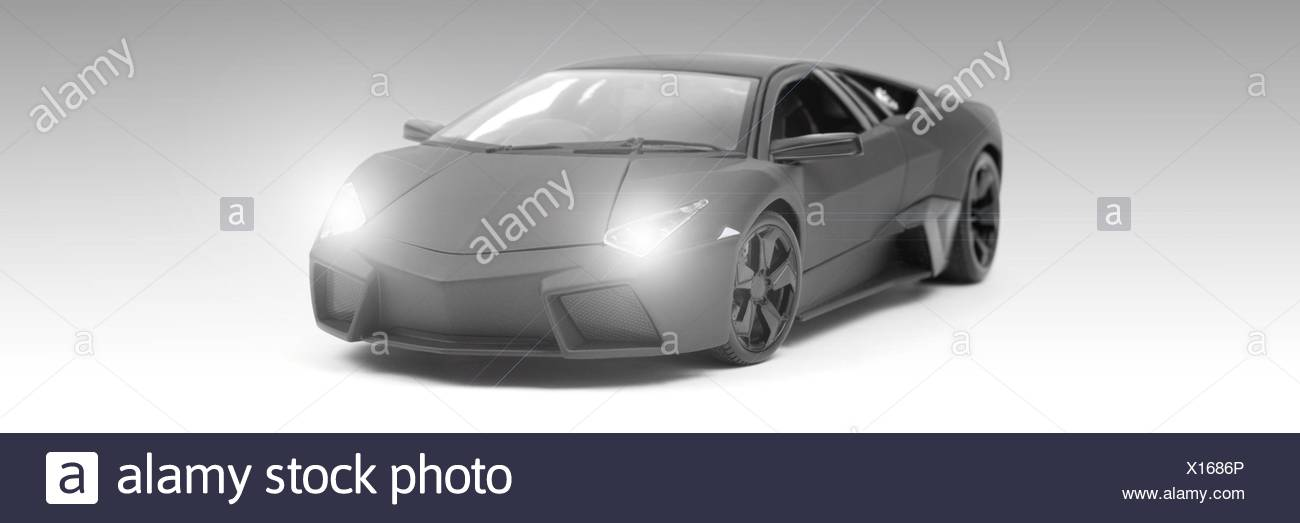 A model sports car isolated against a white background - Stock Image