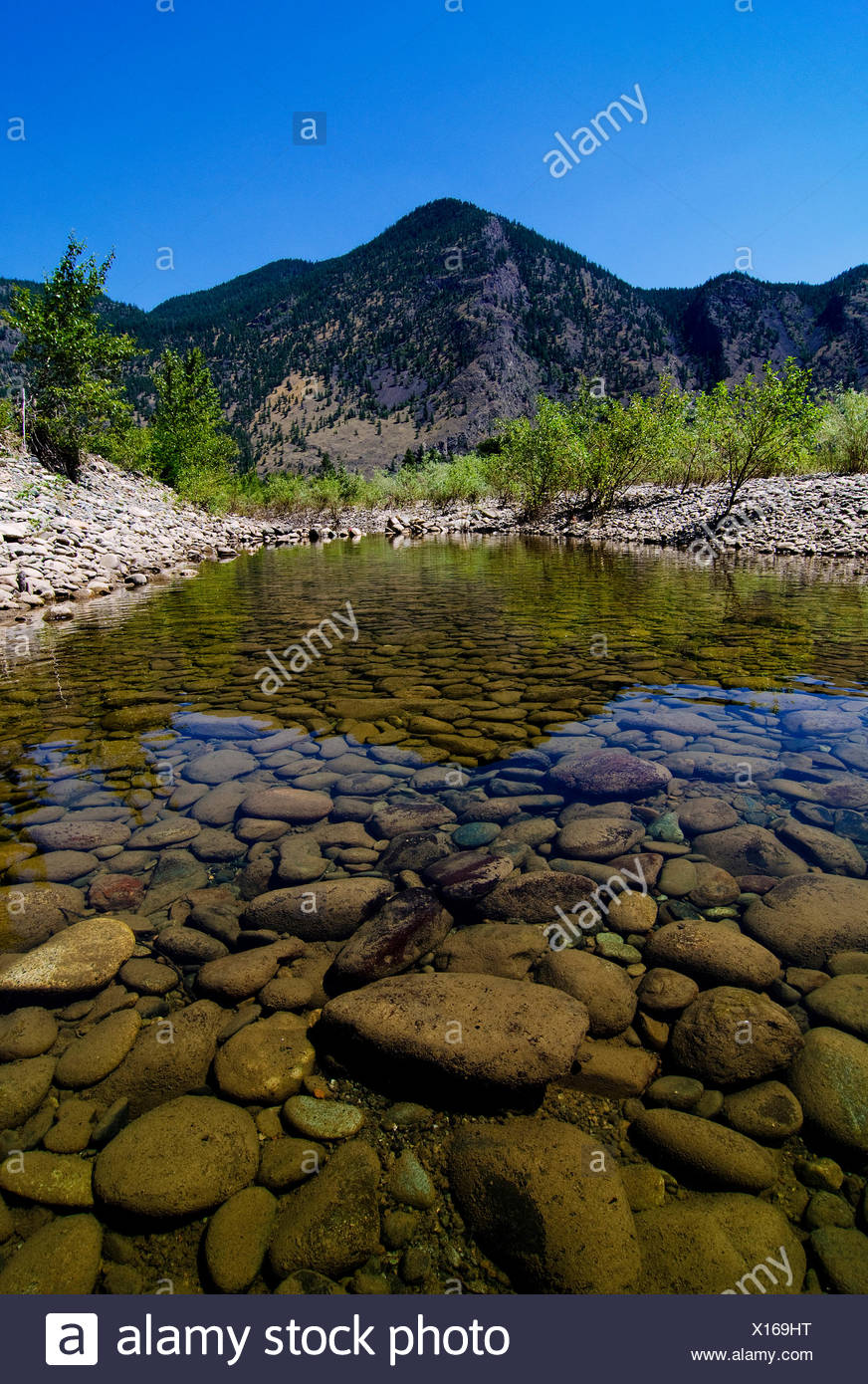 The rocky and rugged terrain along the Similkameen River, near Keremeos, in the Simikameen region of British Columbia, Canada - Stock Image