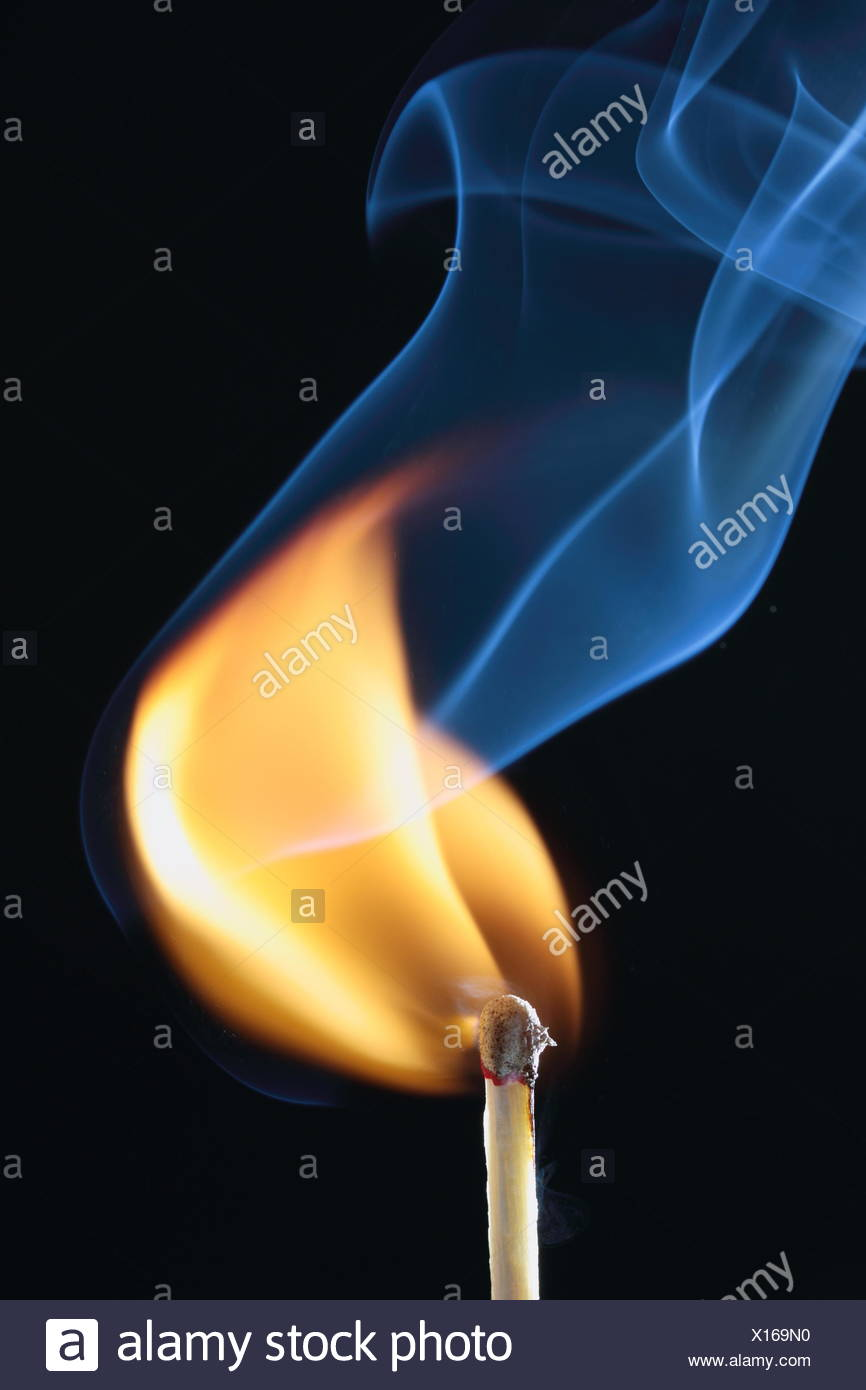 ignited match with blue smoke on black background - Stock Image