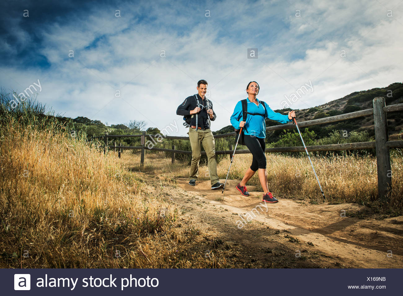 Hikers walking in countryside - Stock Image