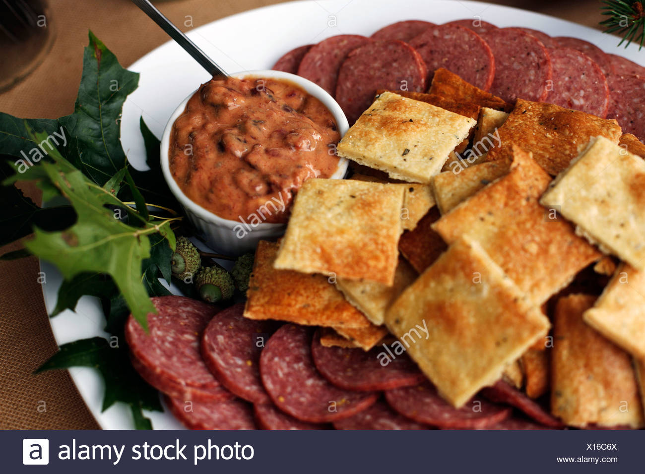Local meats including venison and bison summer sausage. - Stock Image