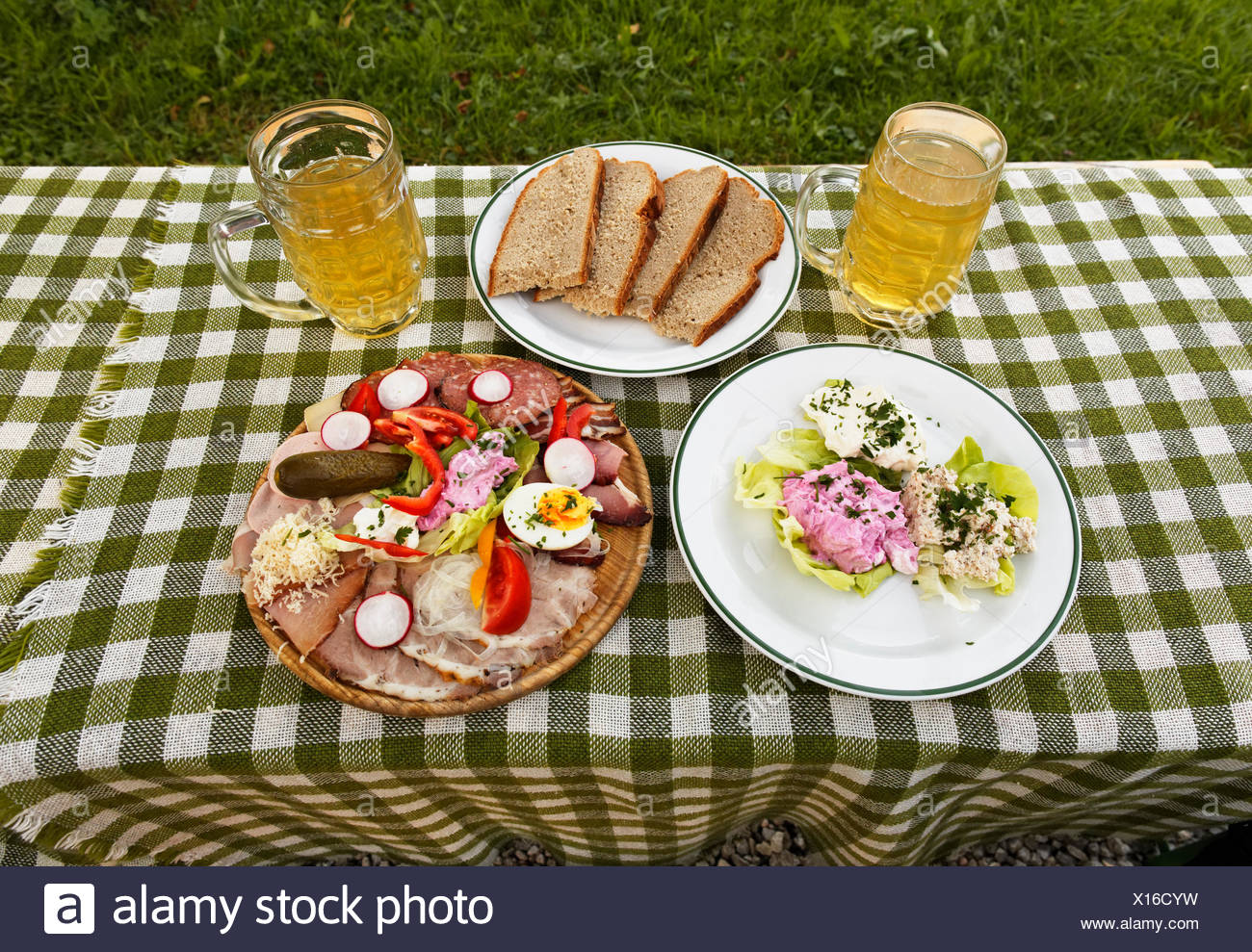 A sausage and cheese platter and some spread on a plate with two glasses of cider & Sausage Cheese Plate Stock Photos \u0026 Sausage Cheese Plate Stock ...