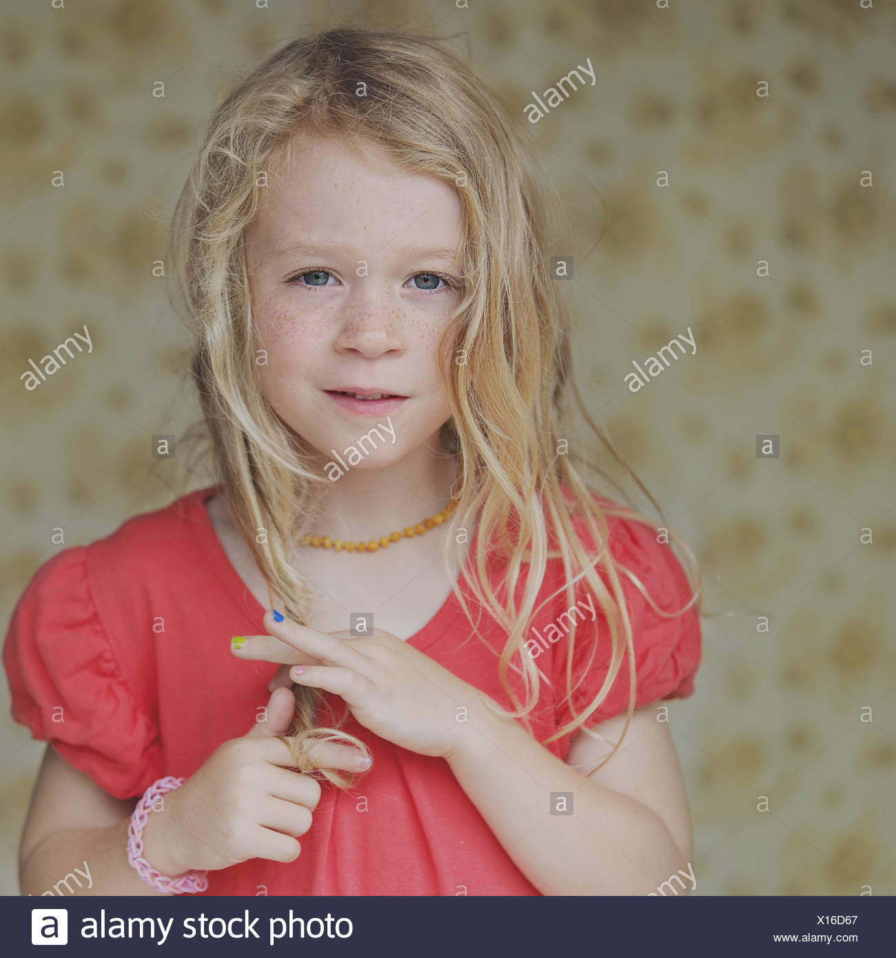 Portrait of a girl playing with her hair - Stock Image