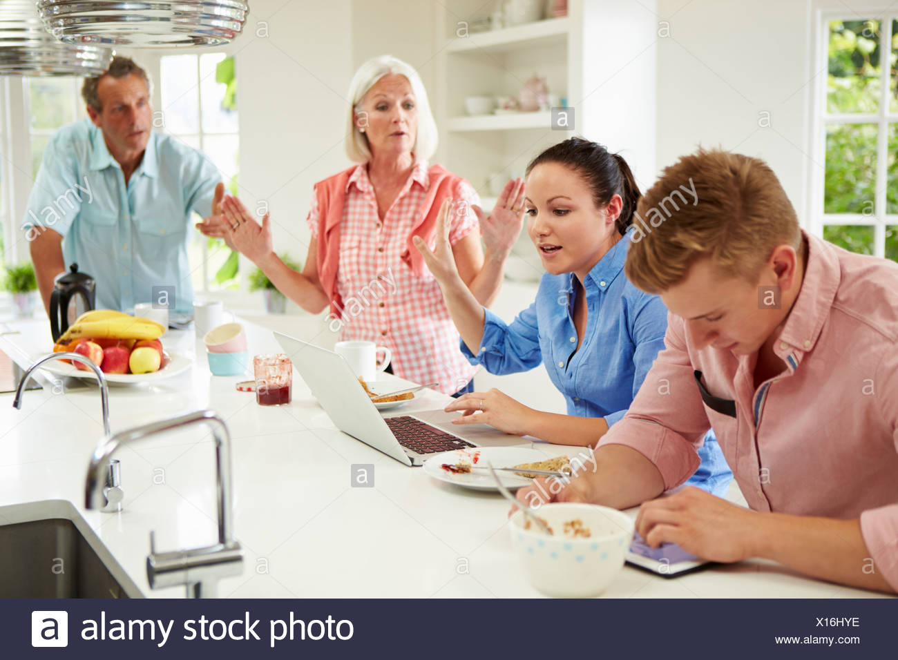 Family With Adult Children Having Argument At Breakfast - Stock Image