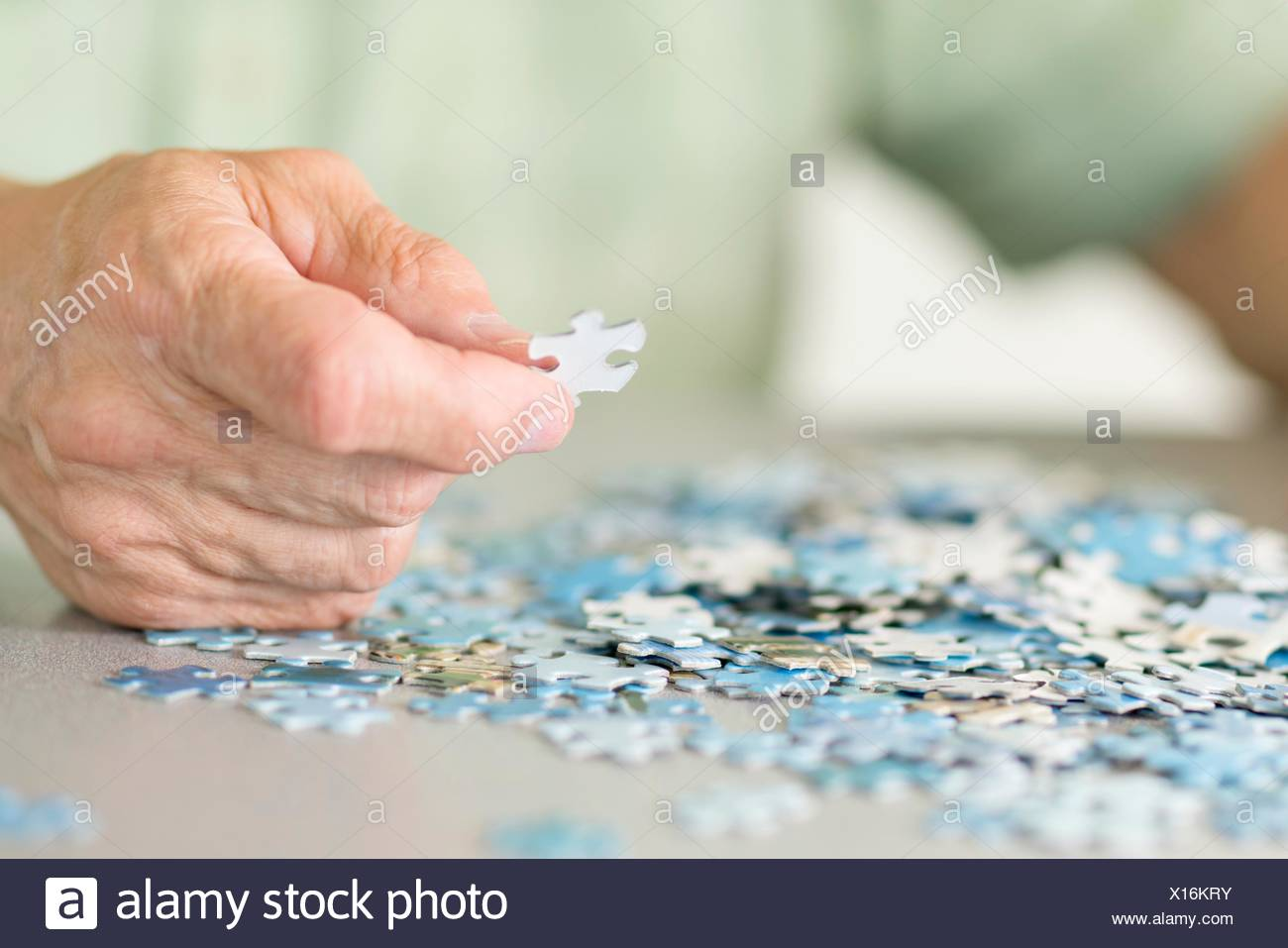 Senior man doing a jigsaw puzzle. - Stock Image