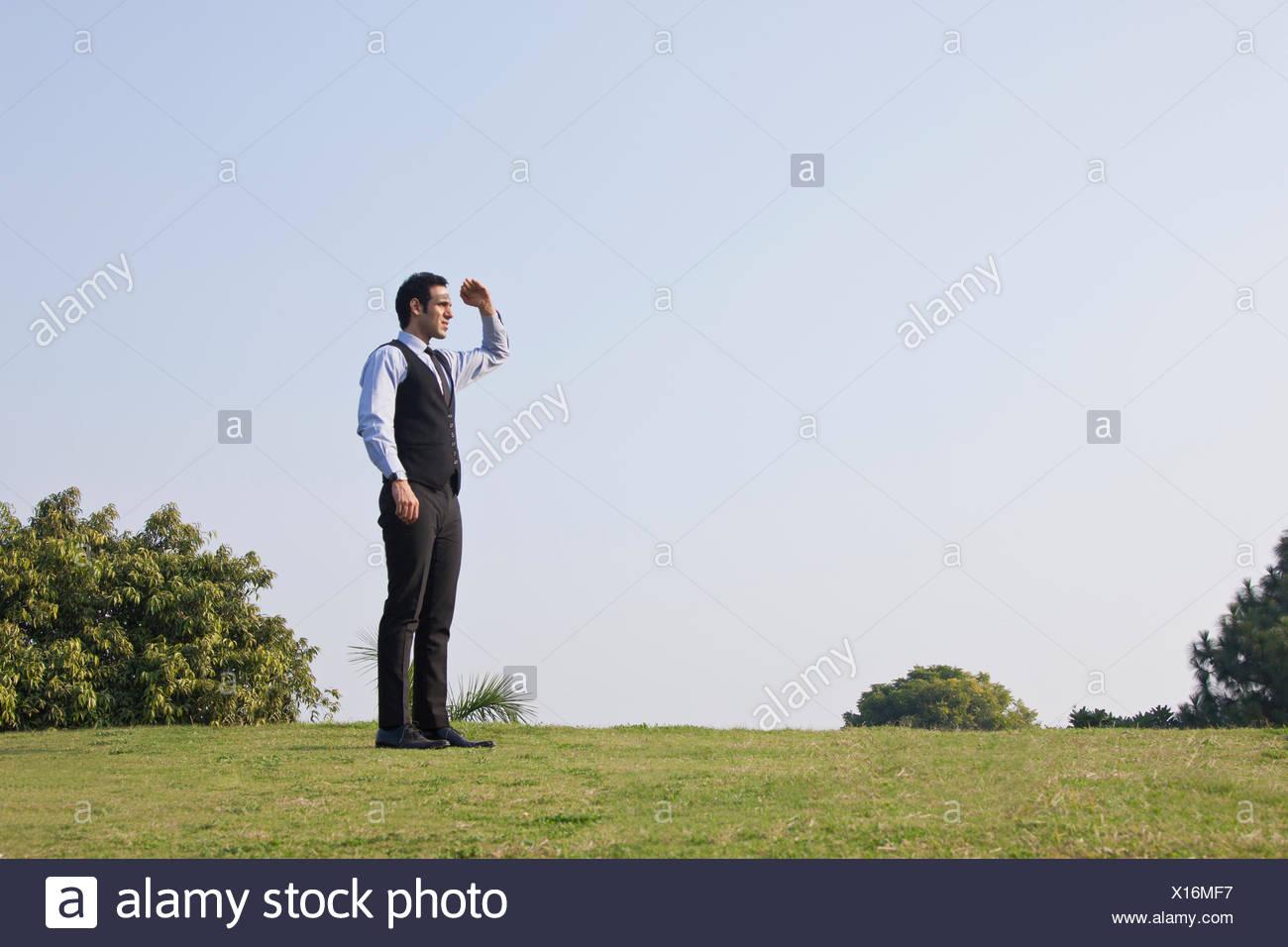 Businessman looking at something , INDIA , DELHI - Stock Image
