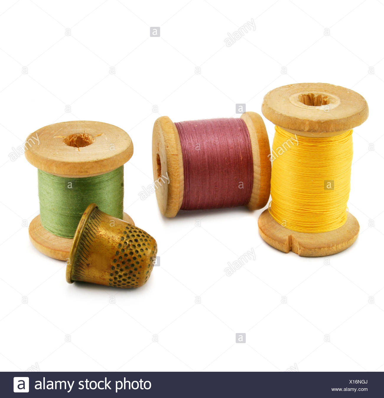 Spools of thread and thimble - Stock Image