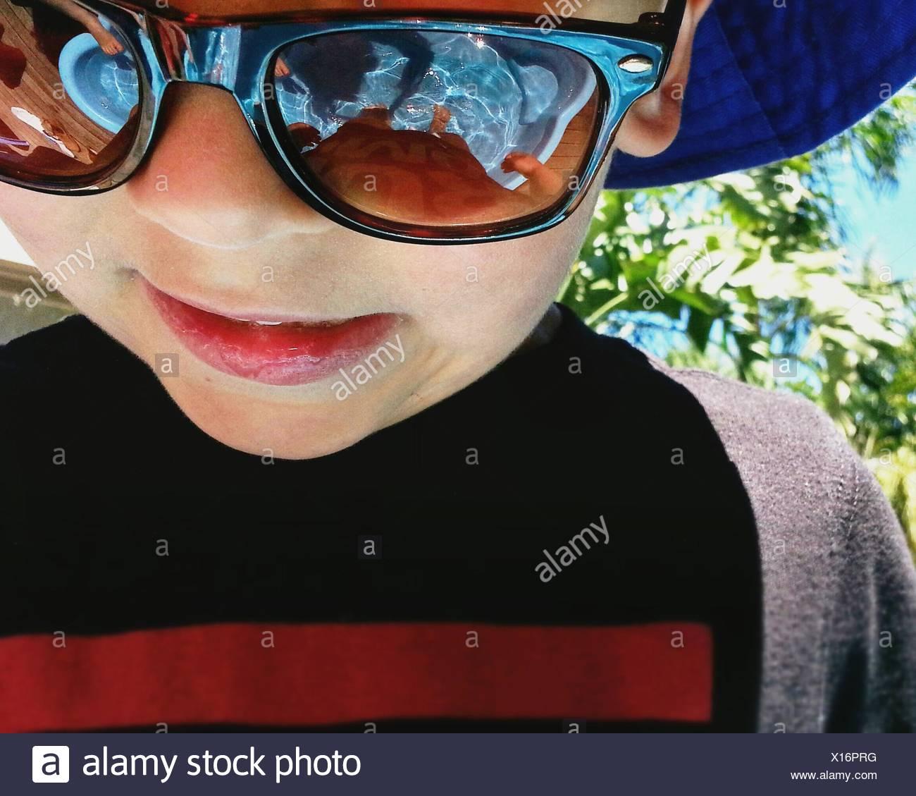 Portrait of a boy wearing sunglasses - Stock Image