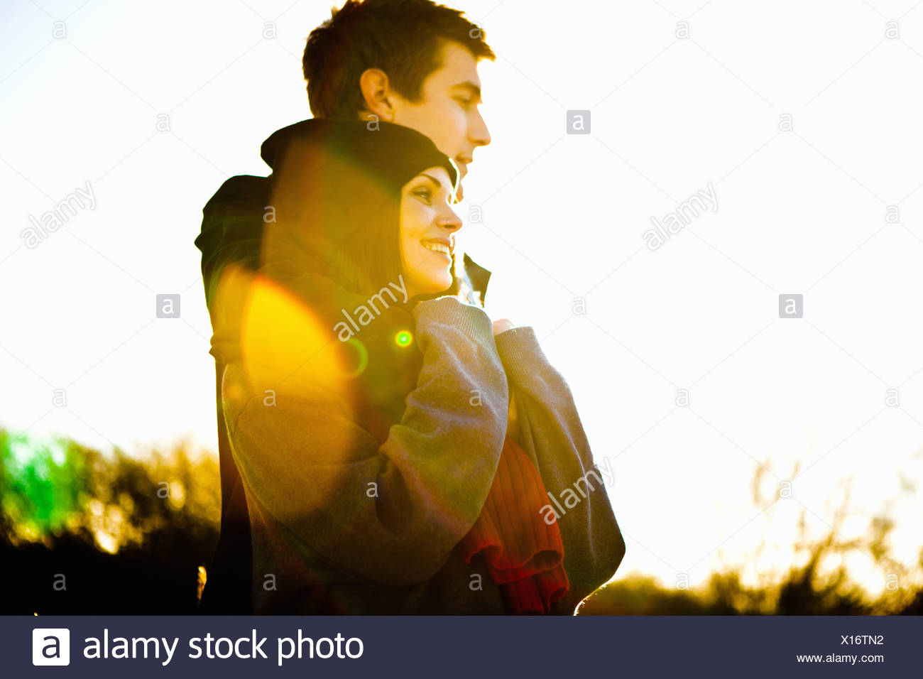 Romantic couple in sunlight Stock Photo