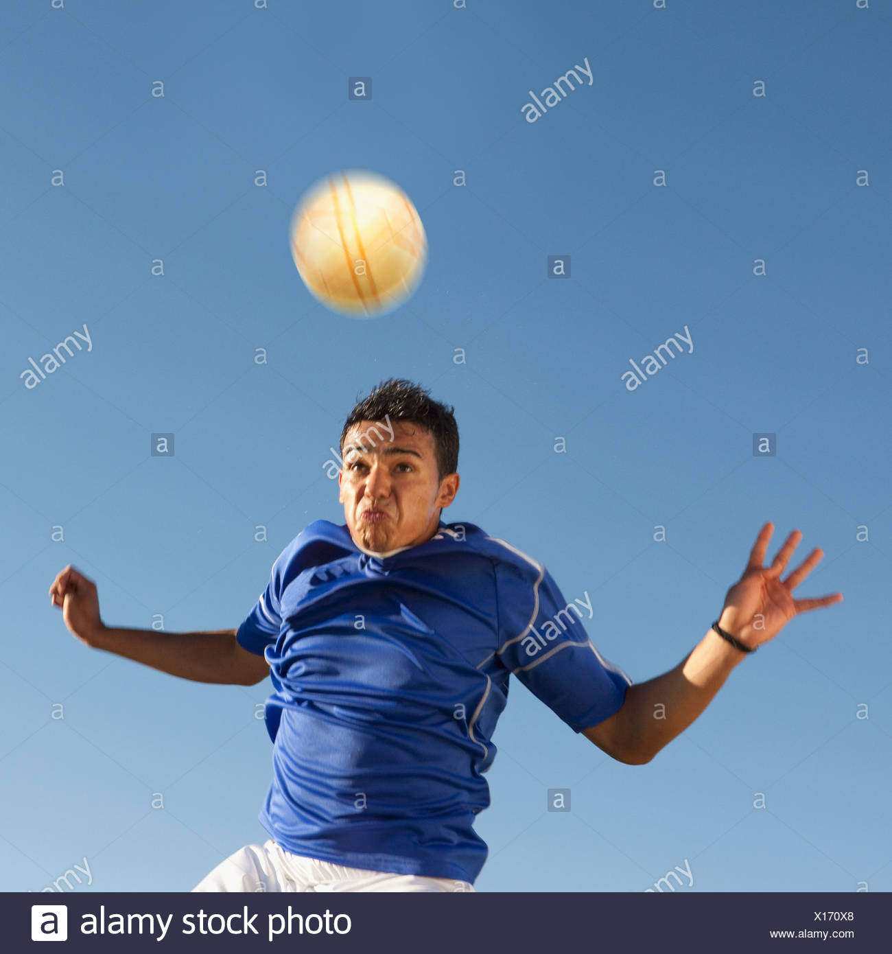 Soccer player heading the ball - Stock Image