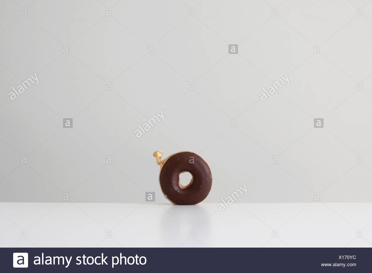 Conceptual donut made from a balloon - Stock Image