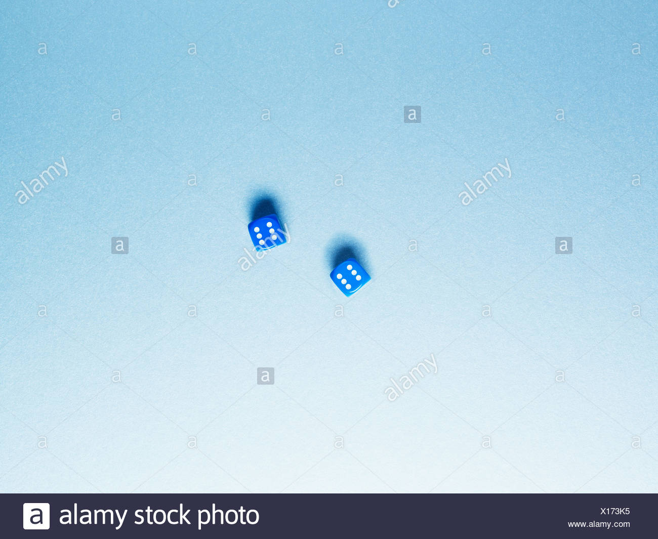 Directly above two blue dice - Stock Image
