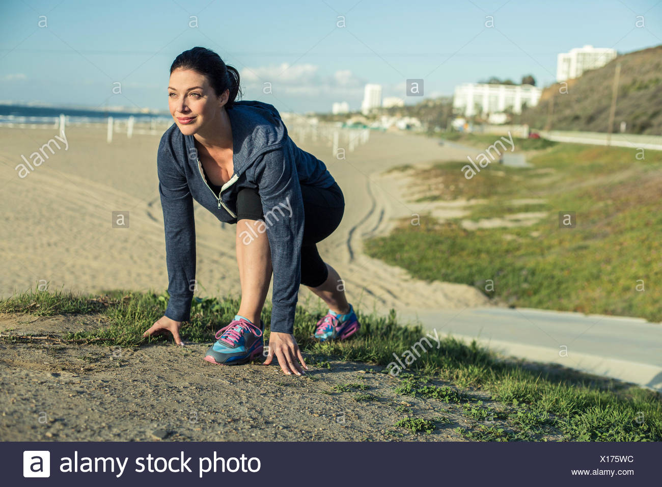 Jogger on her mark by beach Stock Photo