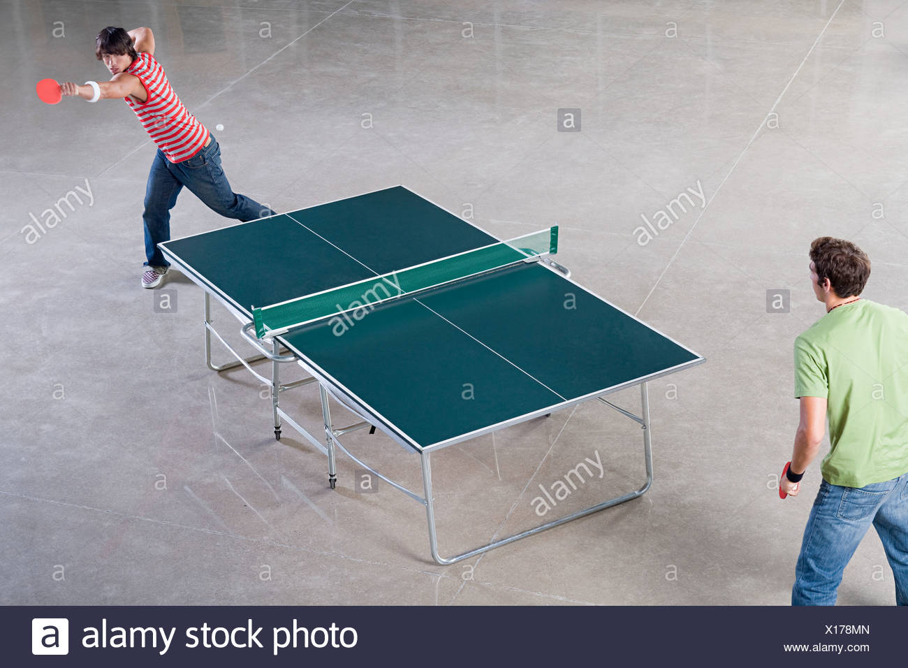 Two Men Playing Table Tennis Stock Photo 276141061 Alamy