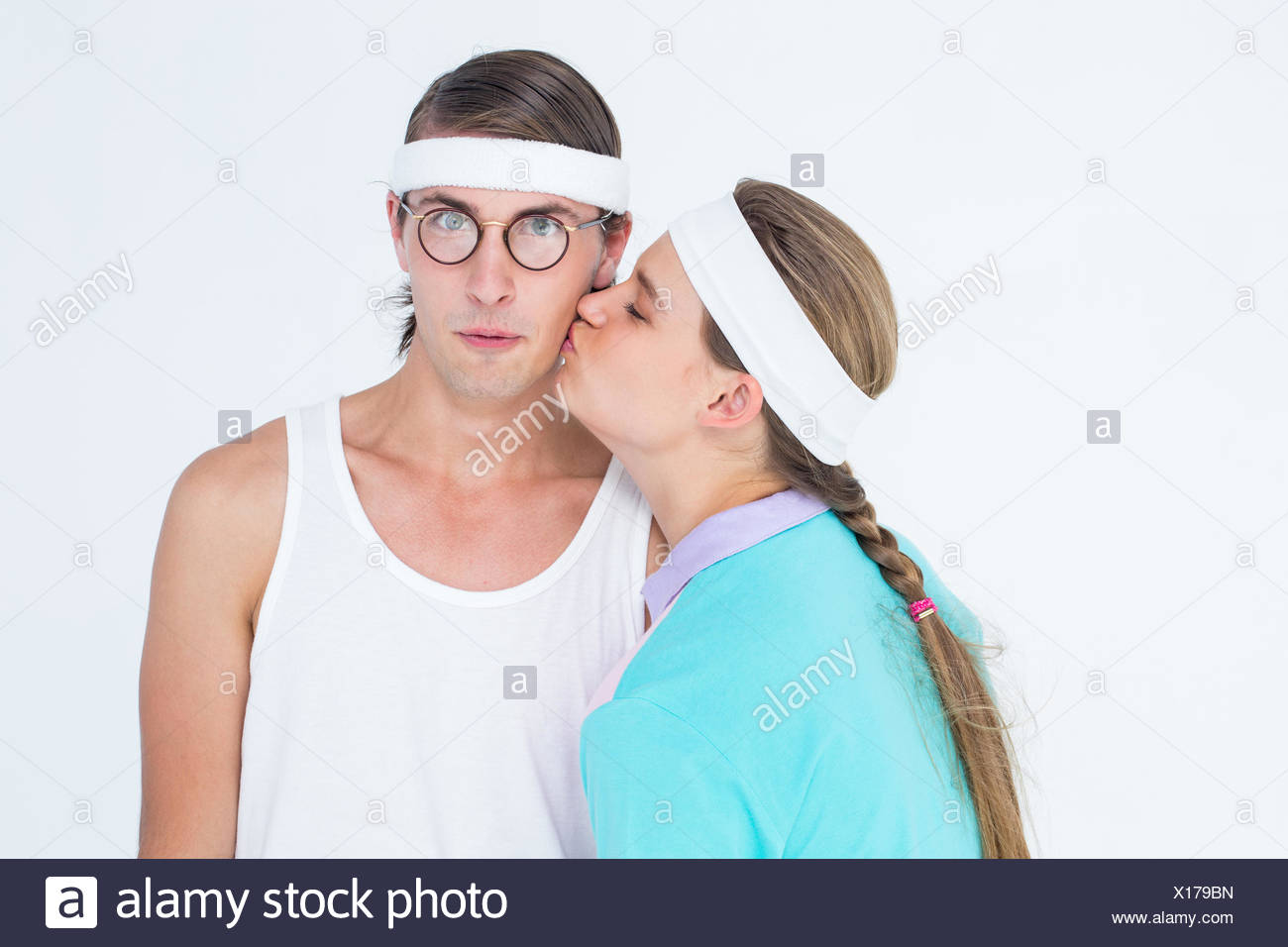 Geeky hipster kissing her boyfriend - Stock Image