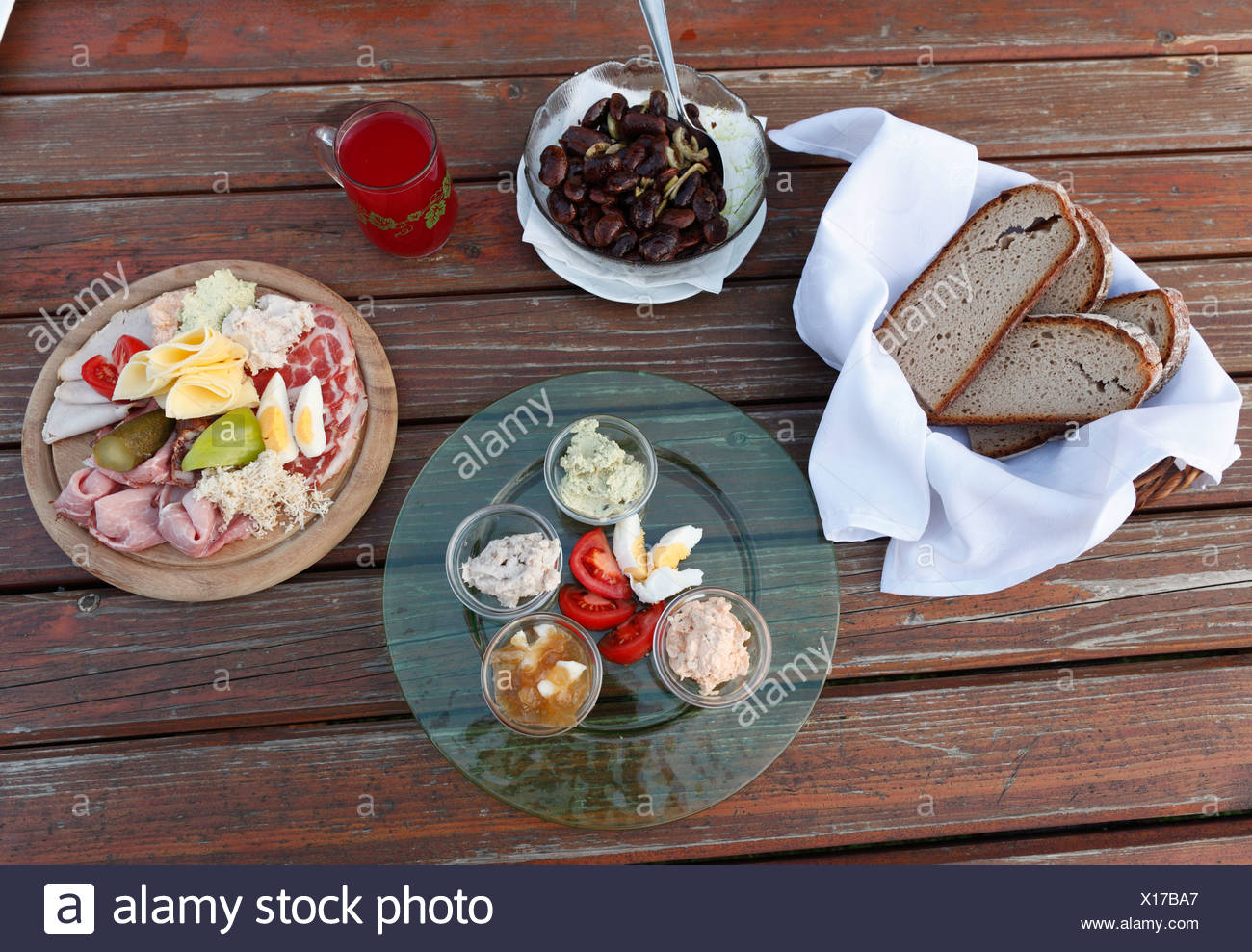 Hearty snack, bread and a plate with a variety of spreads, Brettljause, a plate with cold cuts, Styrian scarlet runner beans and - Stock Image
