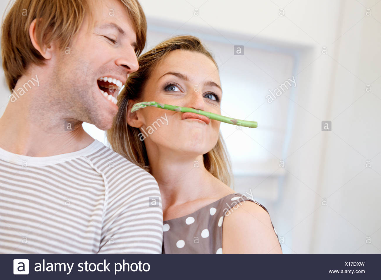 Woman with asparagus moustache - Stock Image