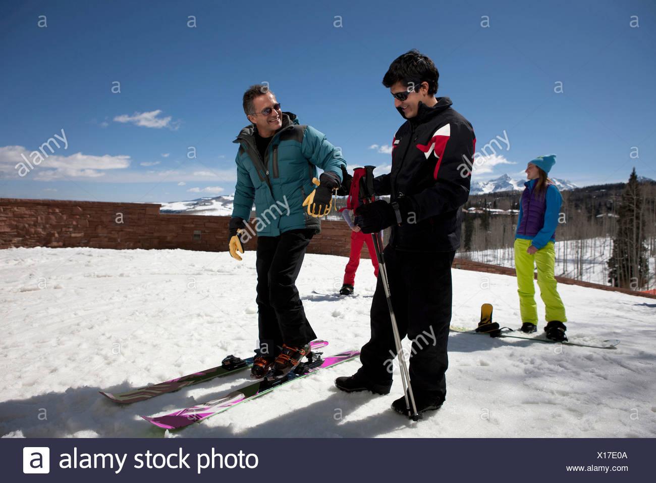 Mature man with ski instructor on ski slope - Stock Image