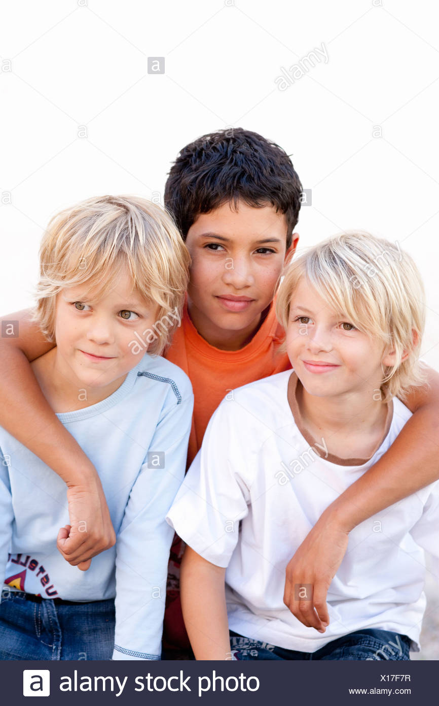Boys smiling together - Stock Image