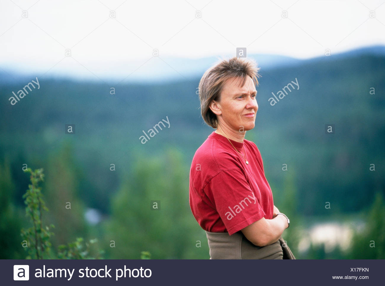 Woman at a mountain top - Stock Image