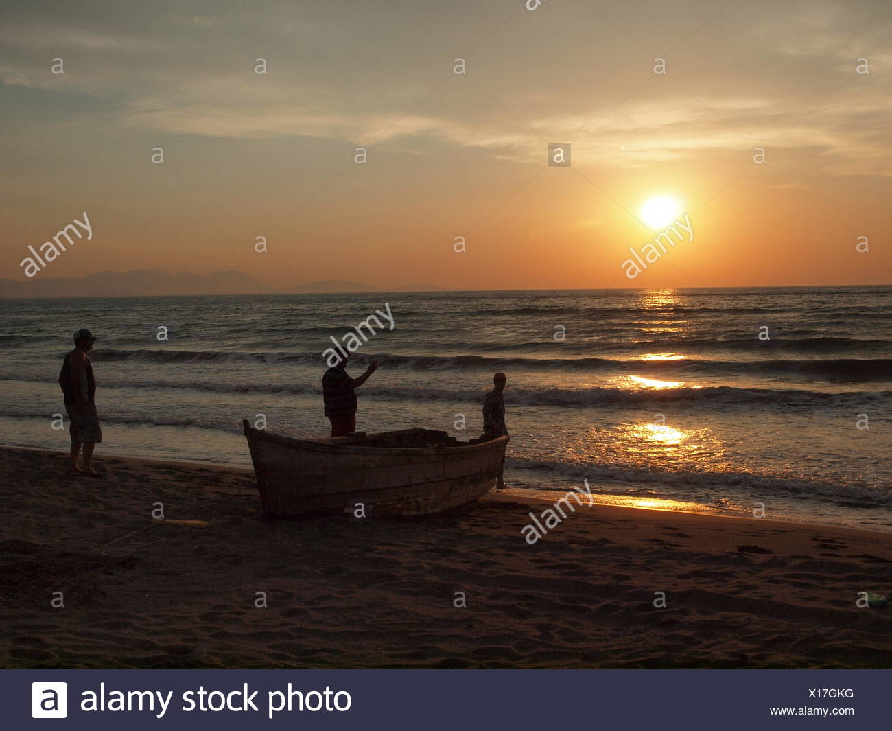 Fishermen in Albania at sunset - Stock Image