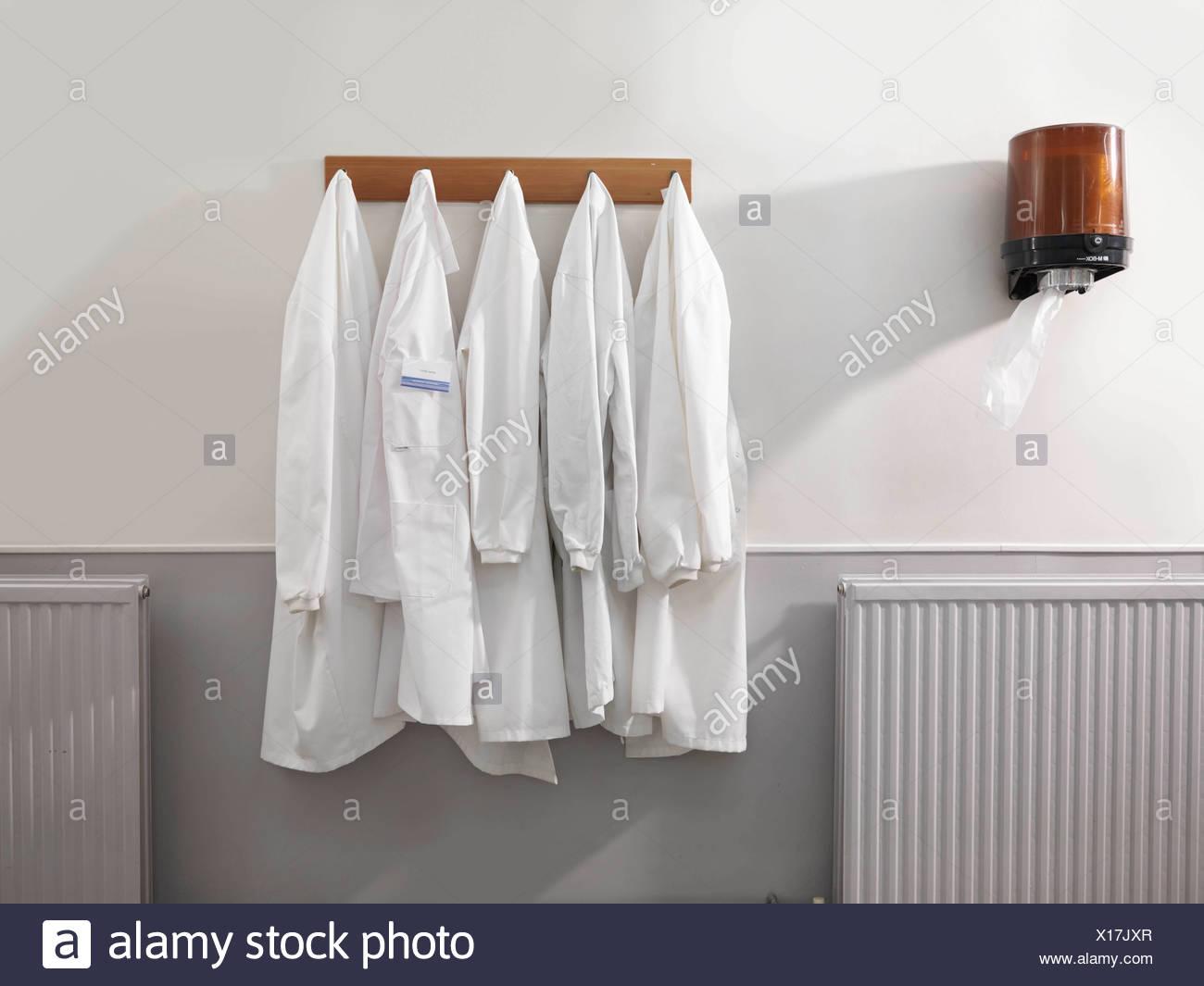 Coats Hanging Stock Photos & Coats Hanging Stock Images - Alamy on white coat storage, white coat shoes, white coat art, white coat clothing, white coat marketing, white coat style, white coat furniture, white coat outfit, white coat books, white coat bench,