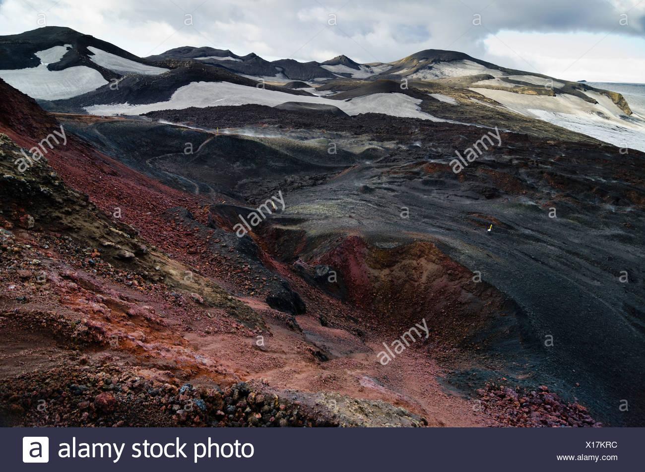 On Fimmvoerðuháls volcano, view of an extinct crater, hiking trail to the Fimmvoerðuháls, Fimmvoerduhals plateau, Suðurland - Stock Image
