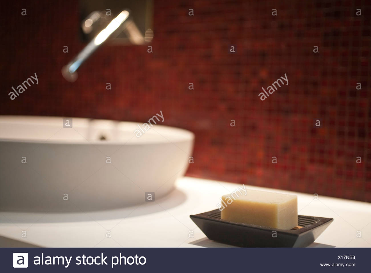 Close-up of bar of soap in soap dish - Stock Image
