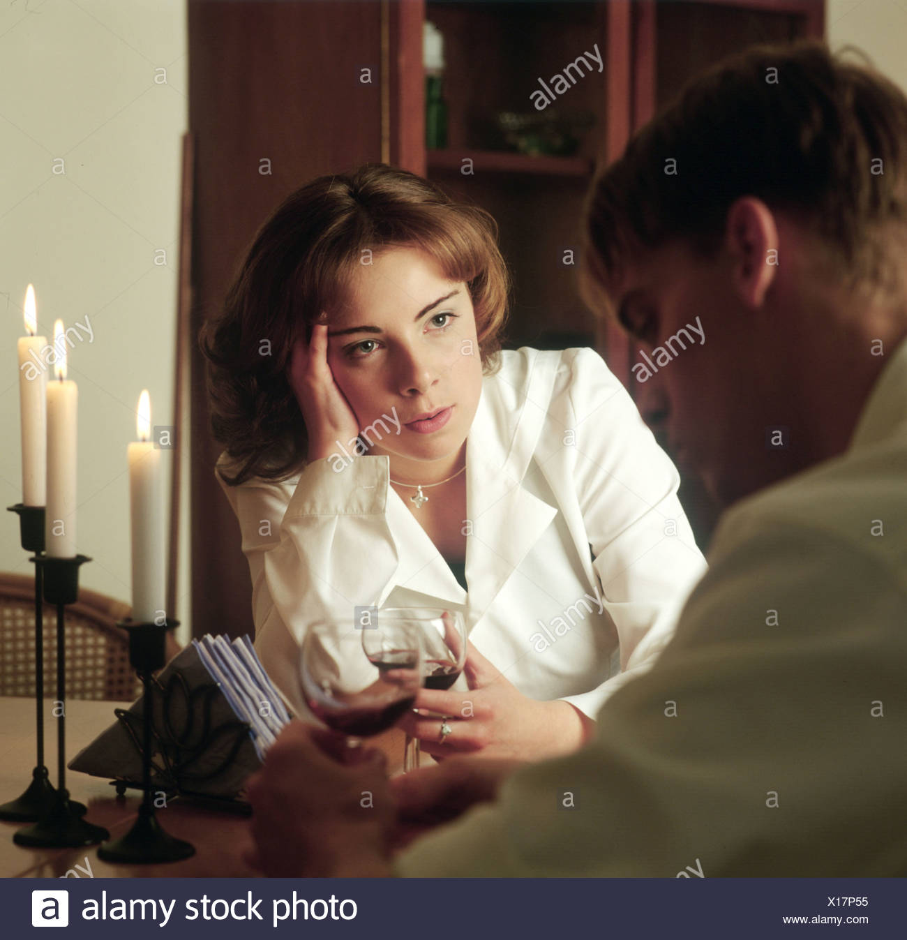 Young couple having a serious conversation at home. - Stock Image