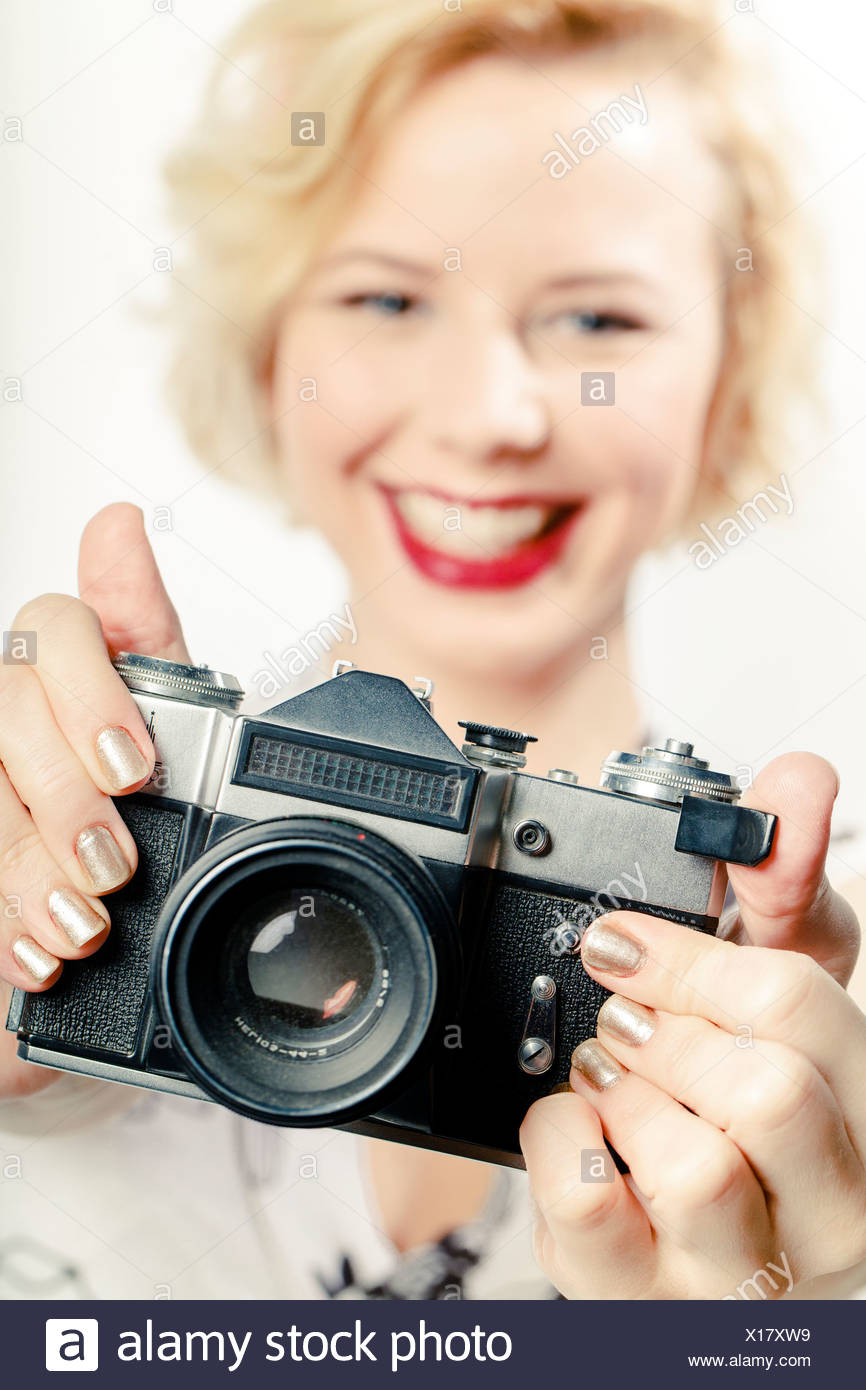Young Woman Using Photo Camera - Stock Image