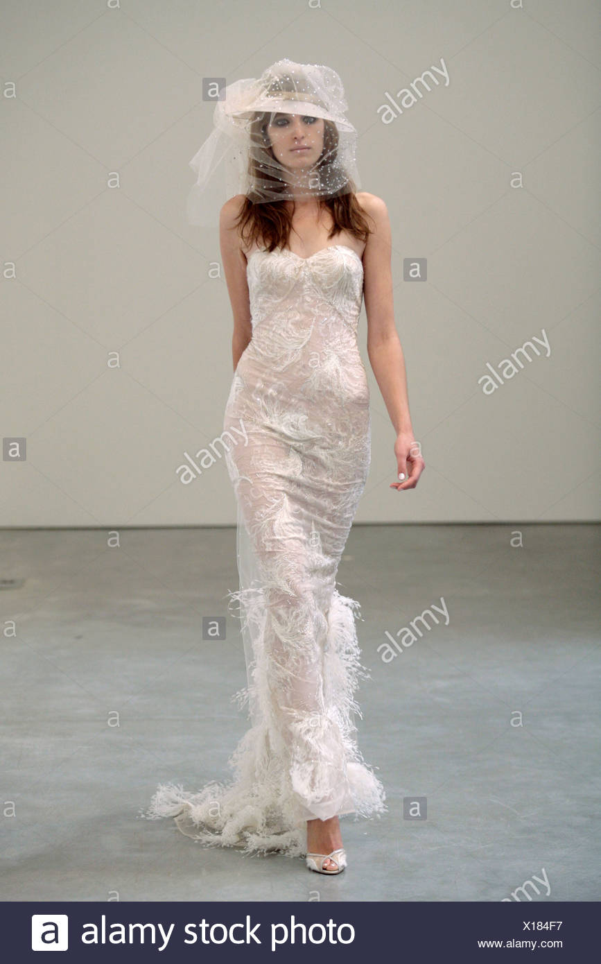Model wearing a white lace hat a veil surrounding it 34db22954c3