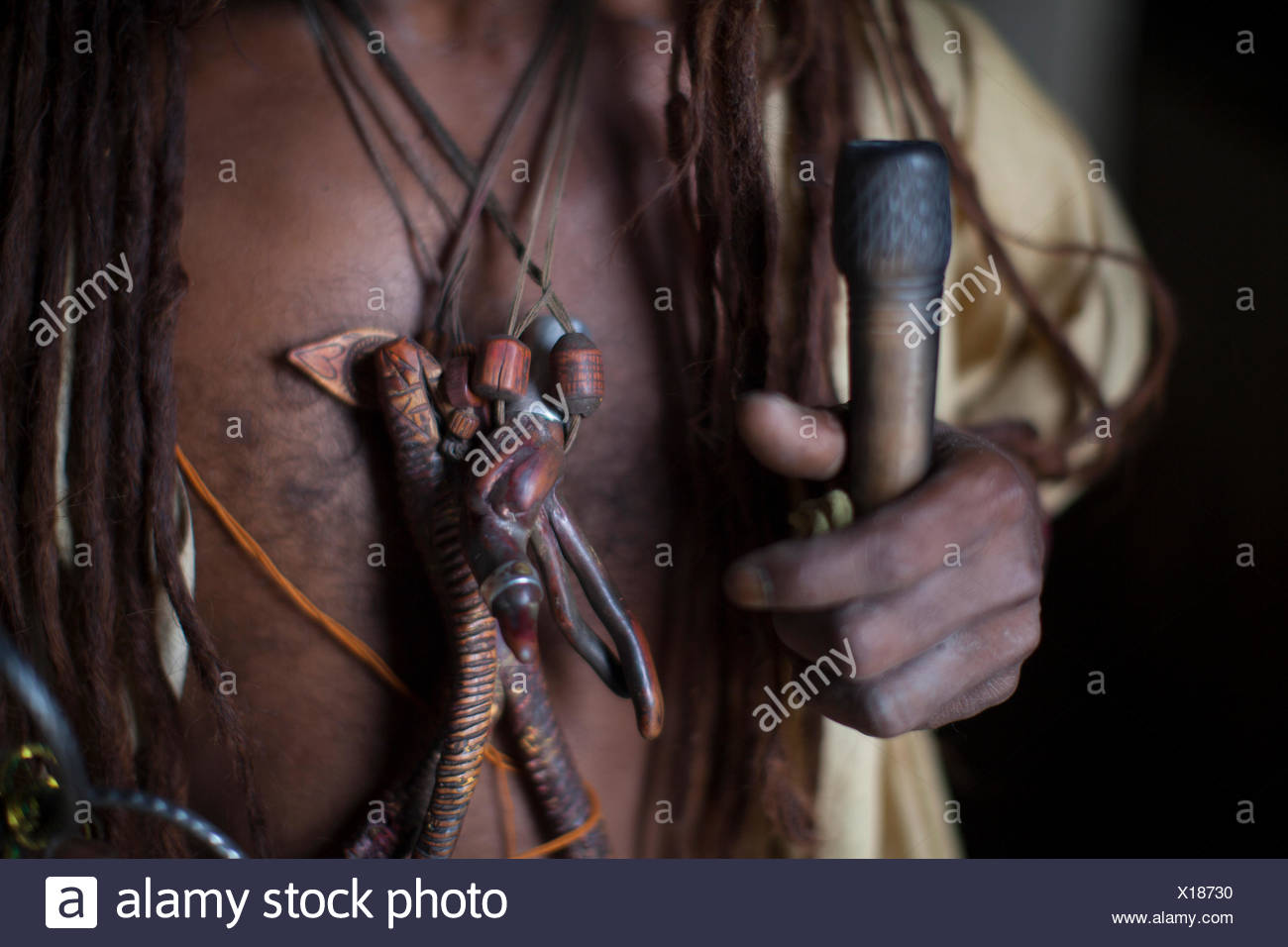 The ornamentation and pipe of a Hindu Sadhu is held in Kathmandu's Pashupatinath Temple in Nepal. Stock Photo