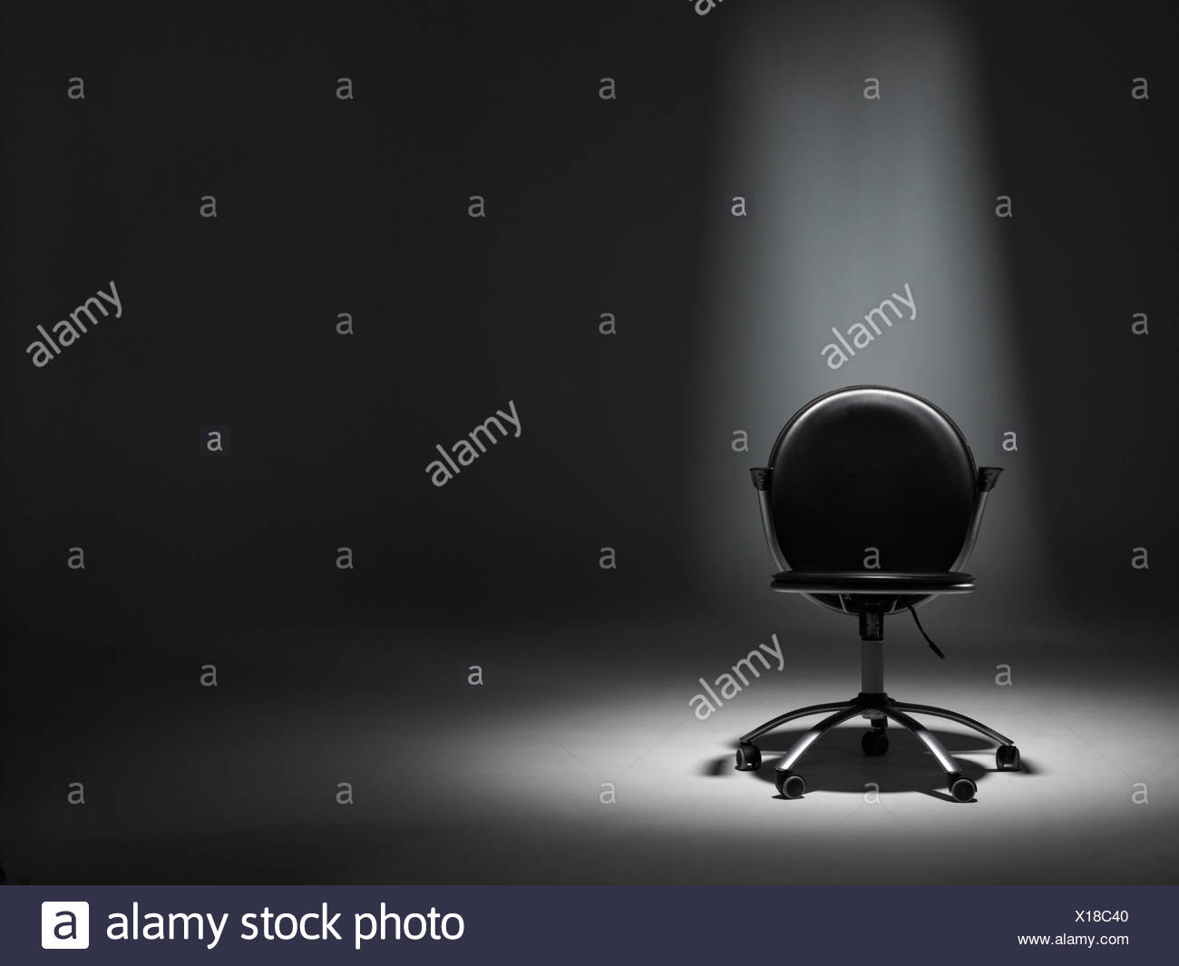 Empty Office Chair In Spotlight - Stock Image