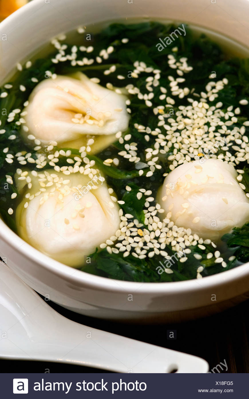 Close-up of Chinese dumplings in a bowl Stock Photo