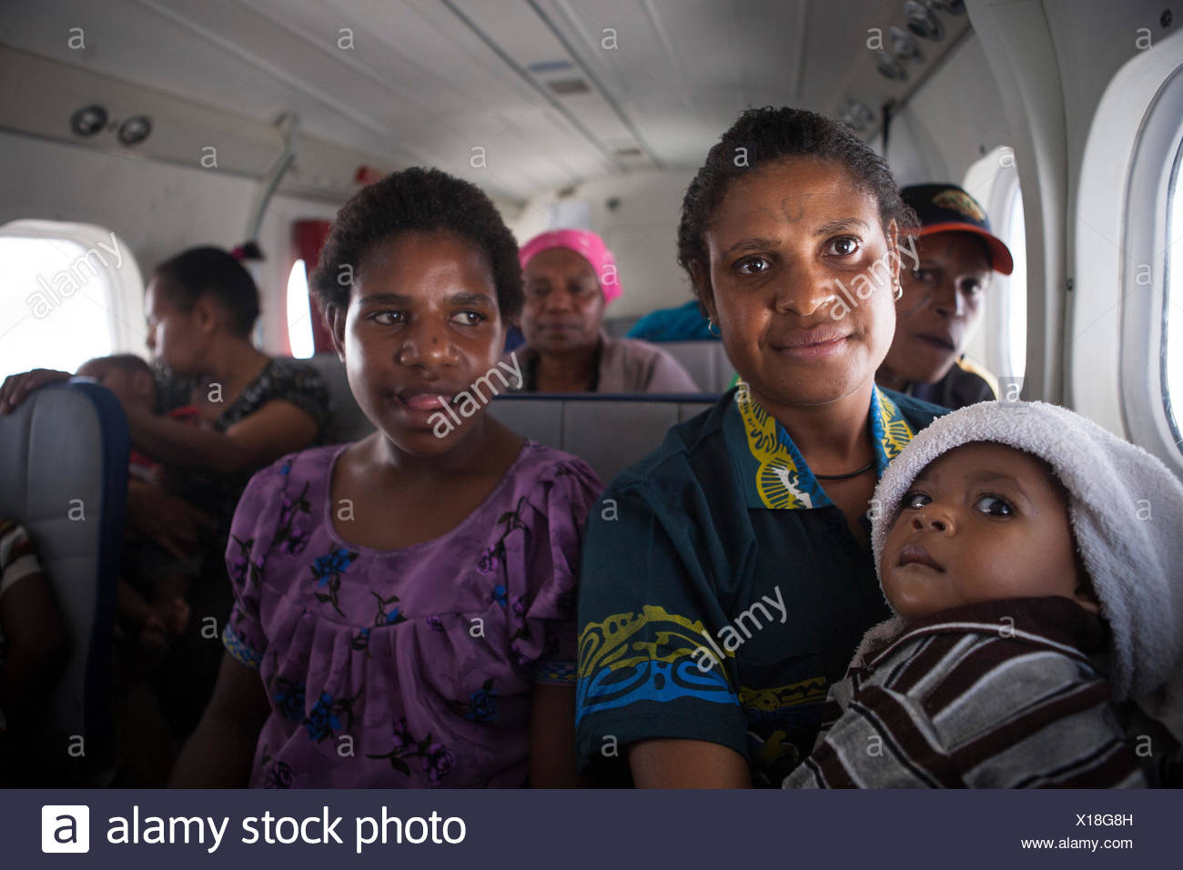 Family in a plane between Telefomin and Tari, Papua New Guinea - Stock Image
