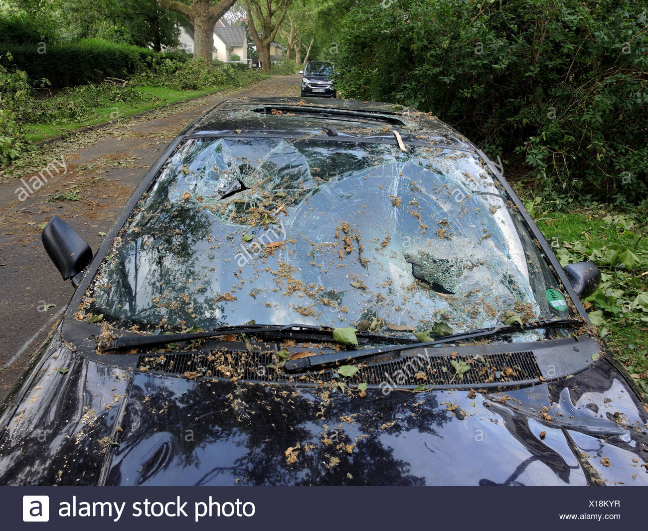 car with broken windscreen, damages by storm front Ela at 2014-06-09, Germany, North Rhine-Westphalia, Ruhr Area, Bochum - Stock Image