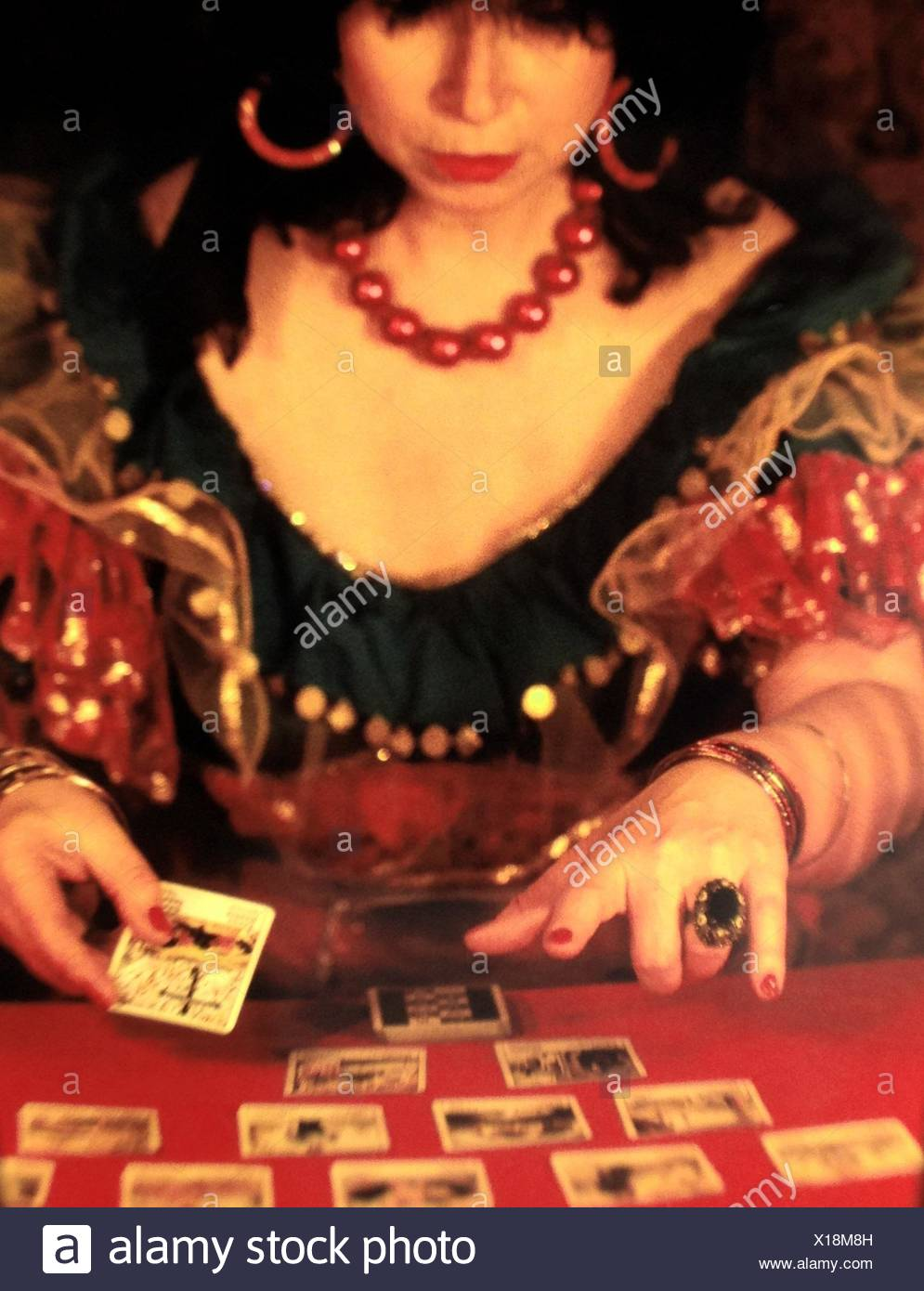 Close-Up Of Woman With Tarot Cards On Table - Stock Image