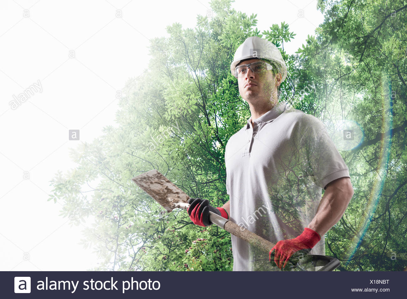 Conceptual image of workman holding spade - Stock Image