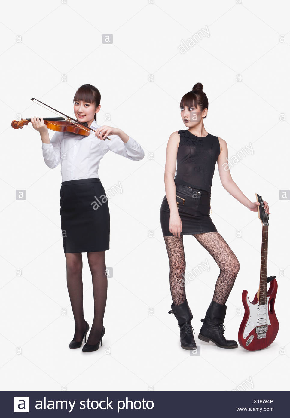 Rock star and violin player, opposite Stock Photo: 276175894