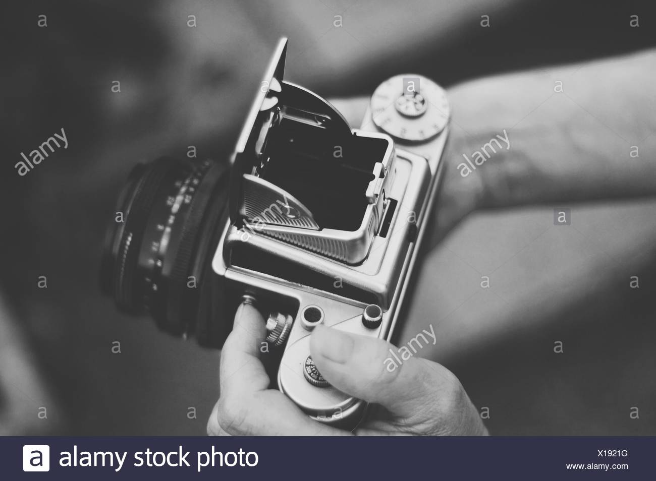 United Kingdom, England, Warwickshire, Stratford-upon-Avon, Woman holding old vintage medium format camera - Stock Image