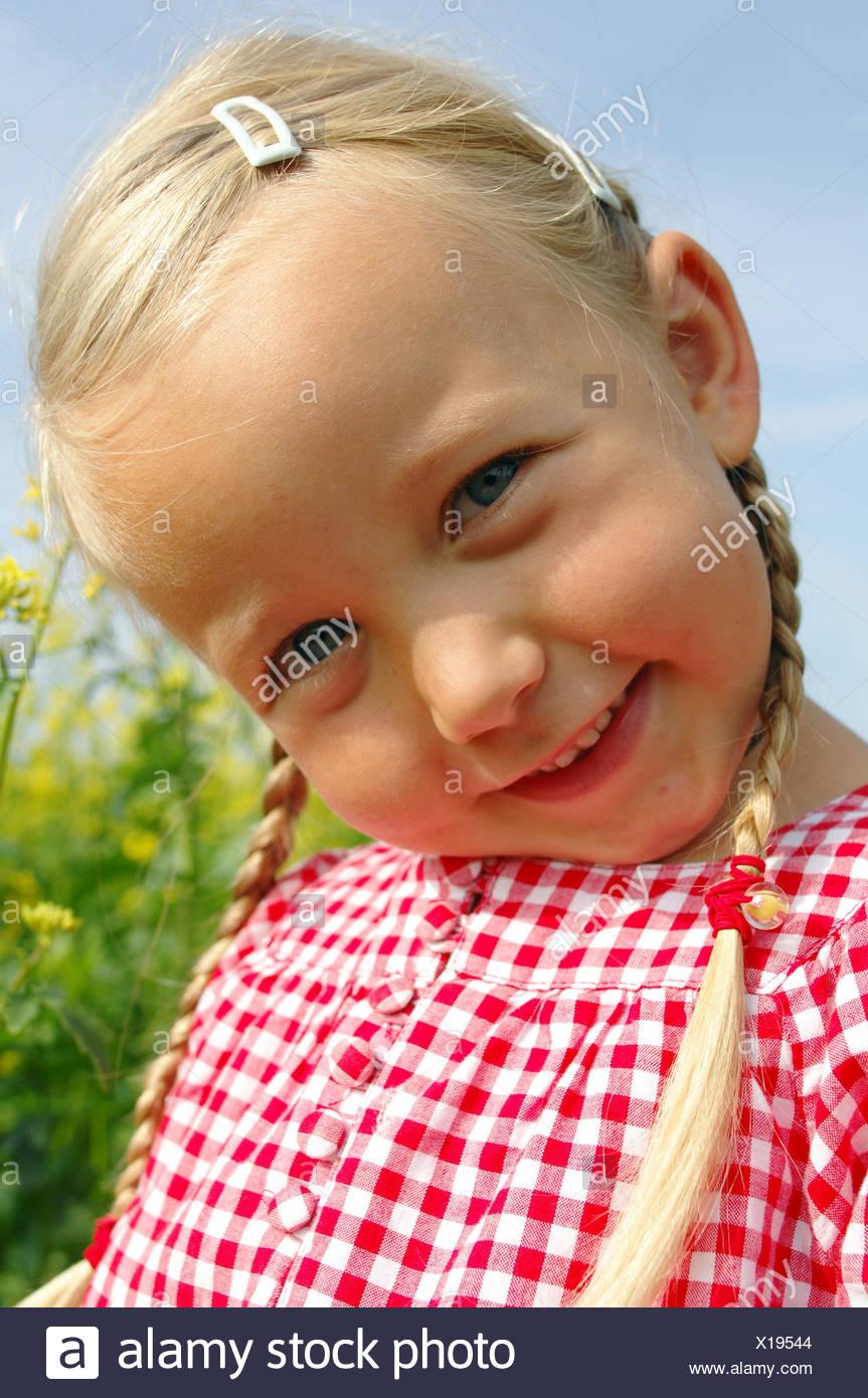 Girls, blond, plaits, portrait, - Stock Image