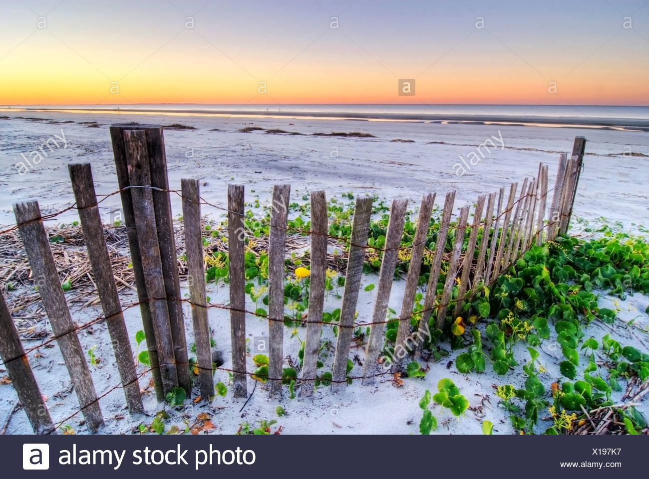 A beach fence at sunset on Hilton Head Island, South Carolina. - Stock Image