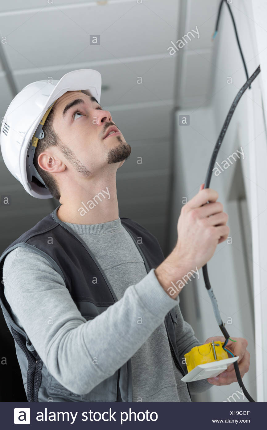 Stupendous Electrician Rewiring Light Switch In Office Stock Photo 276187983 Wiring Cloud Hisonuggs Outletorg