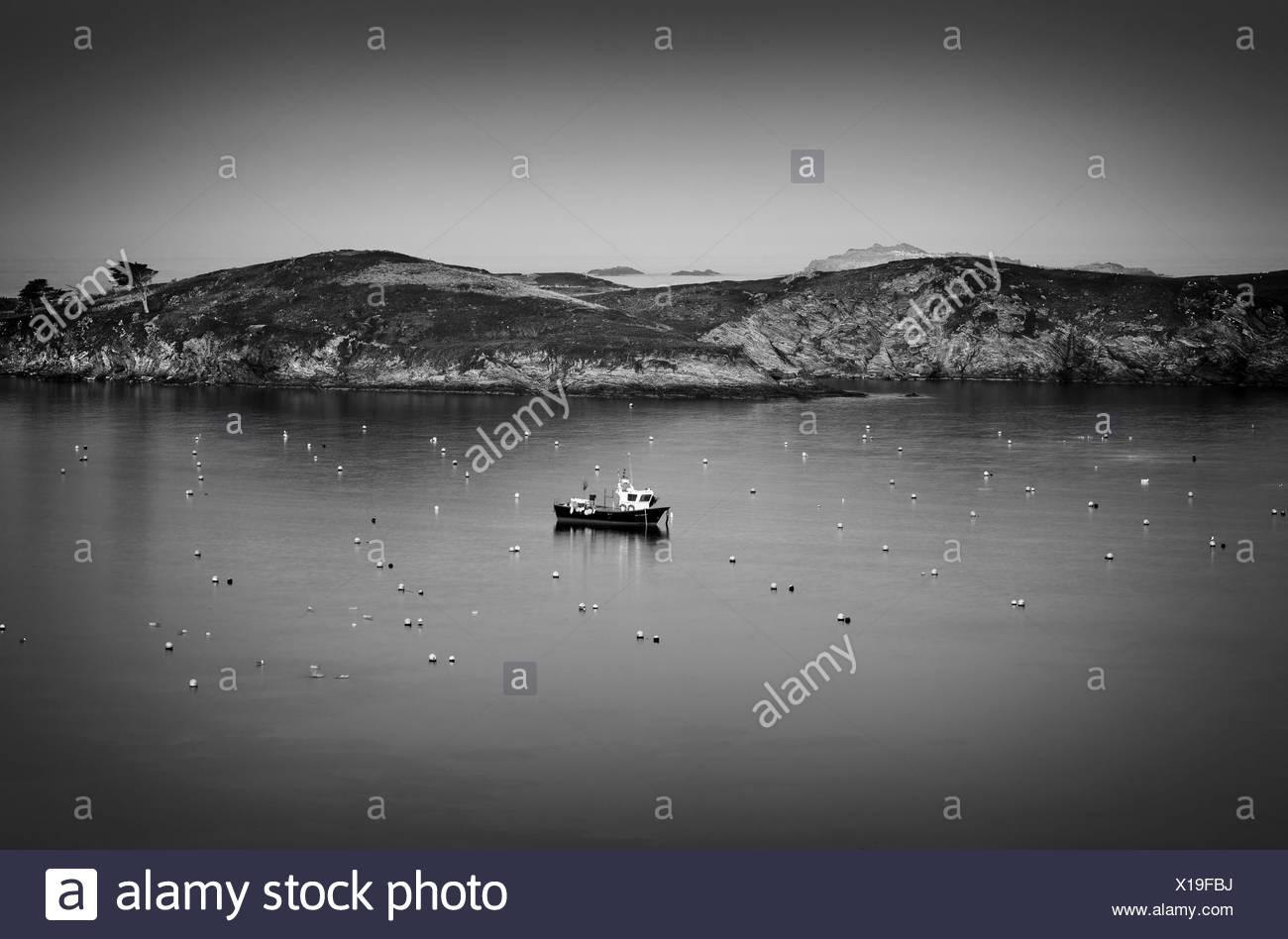 Ship anchored in the bay of Port Lligat, Costa Brava, Catalonia, Spain - Stock Image