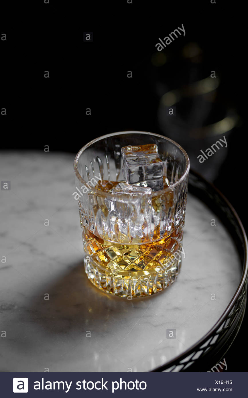 Cognac in a tumbler on a table - Stock Image