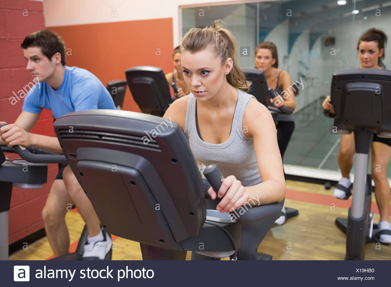 People working out at spinning class Stock Photo