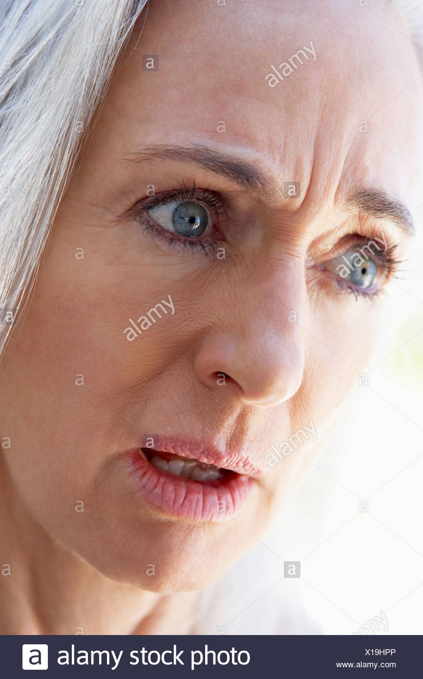 Portrait Of Senior Woman Looking Upset - Stock Image