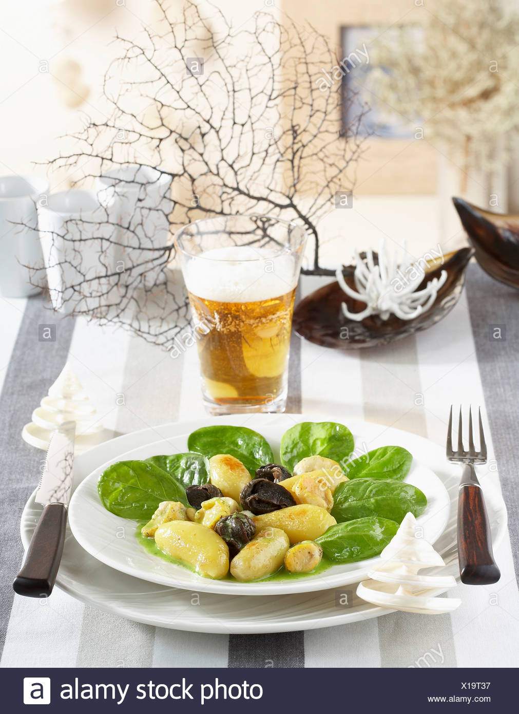 Touquet Ratte potatoes with whelks,snails and spinach shoots Stock Photo