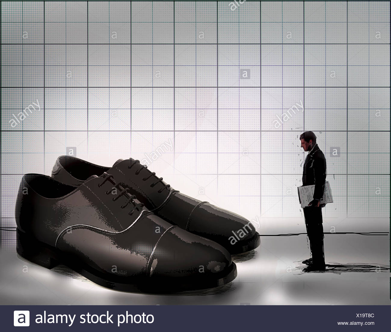 Ambitious businessman looking at large pair of empty shoes - Stock Image